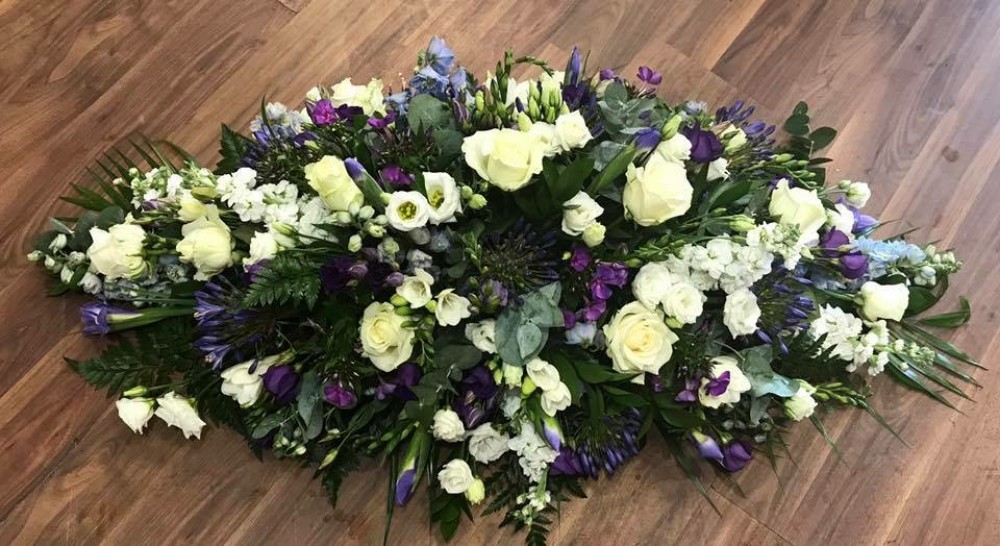 Purple and white summer casket spray the flower shop beeston mightylinksfo